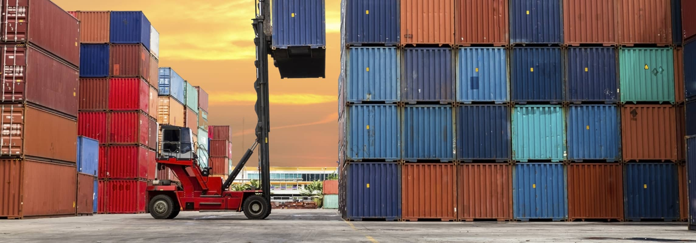 Forklift moving shipping containers