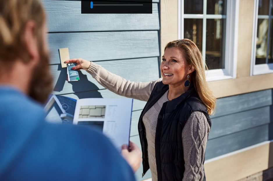 Woman scanning card outside