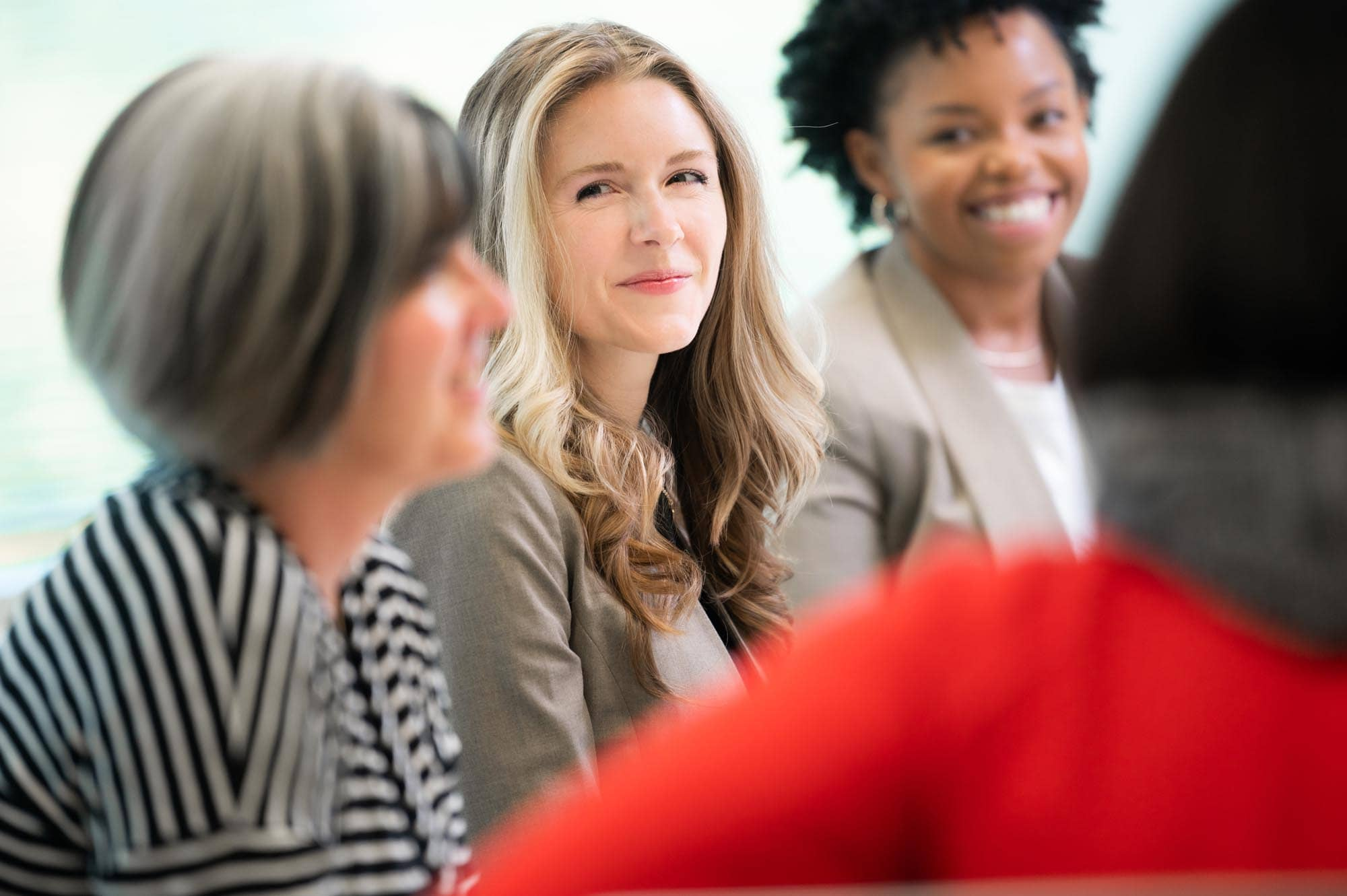 Woman smiling in boardroom