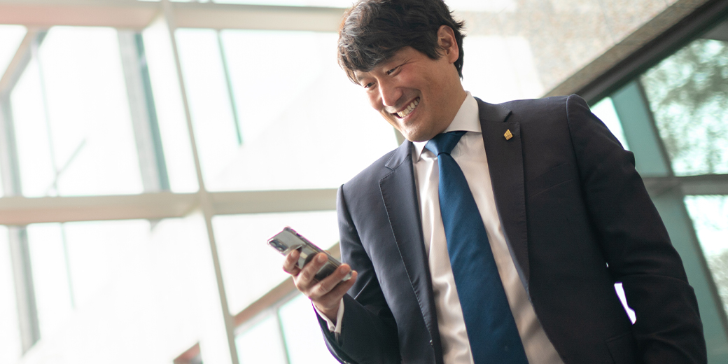 Markel employee smiling and talking on phone