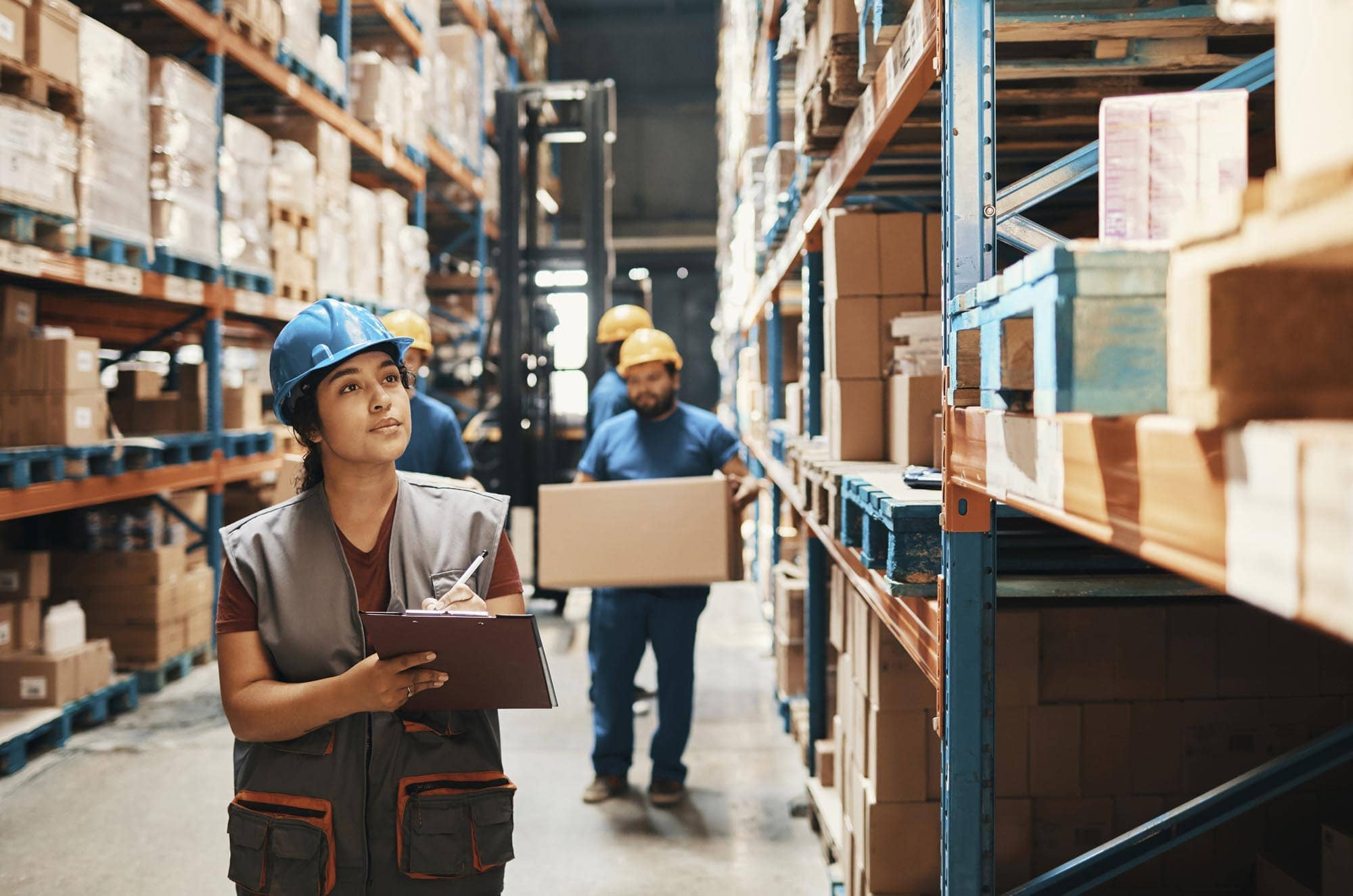 Working wearing hard hat in commercial warehouse