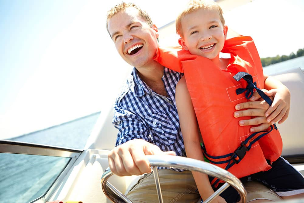 Father and son boating
