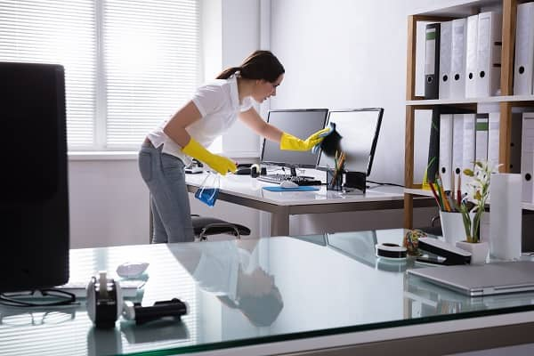 Woman cleaning office