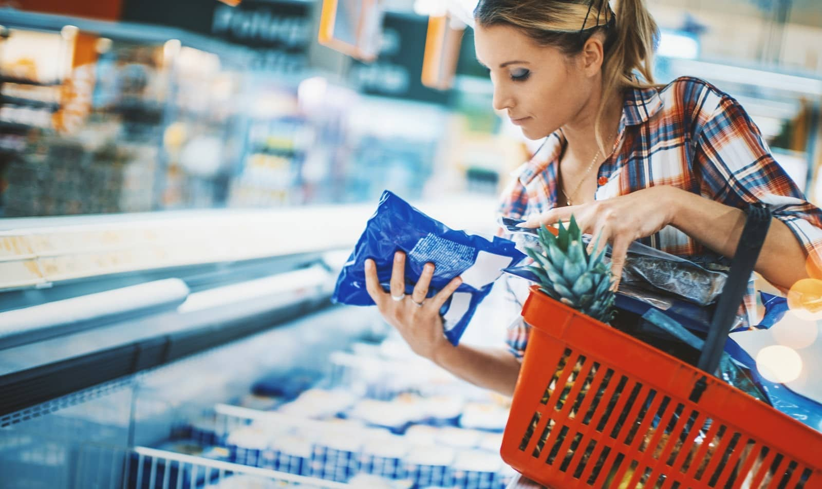 Woman bying frozen food at a supermarket.
