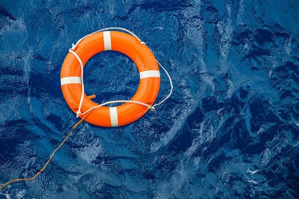 Life Preserver on Blue Water