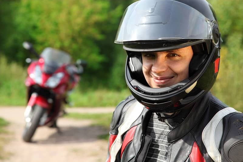 Smiling motorcyclist