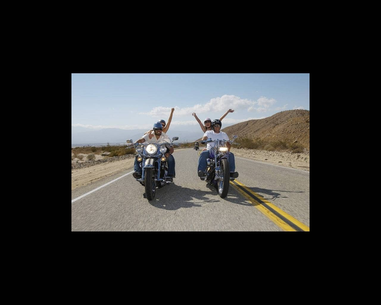 Couples riding motorcycles