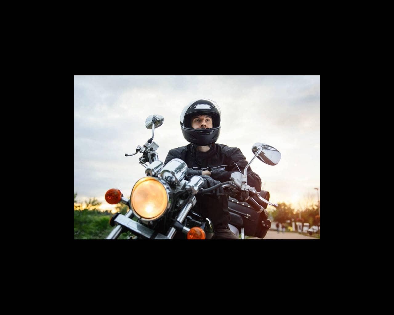 Biker wearing helmet on motorcycle