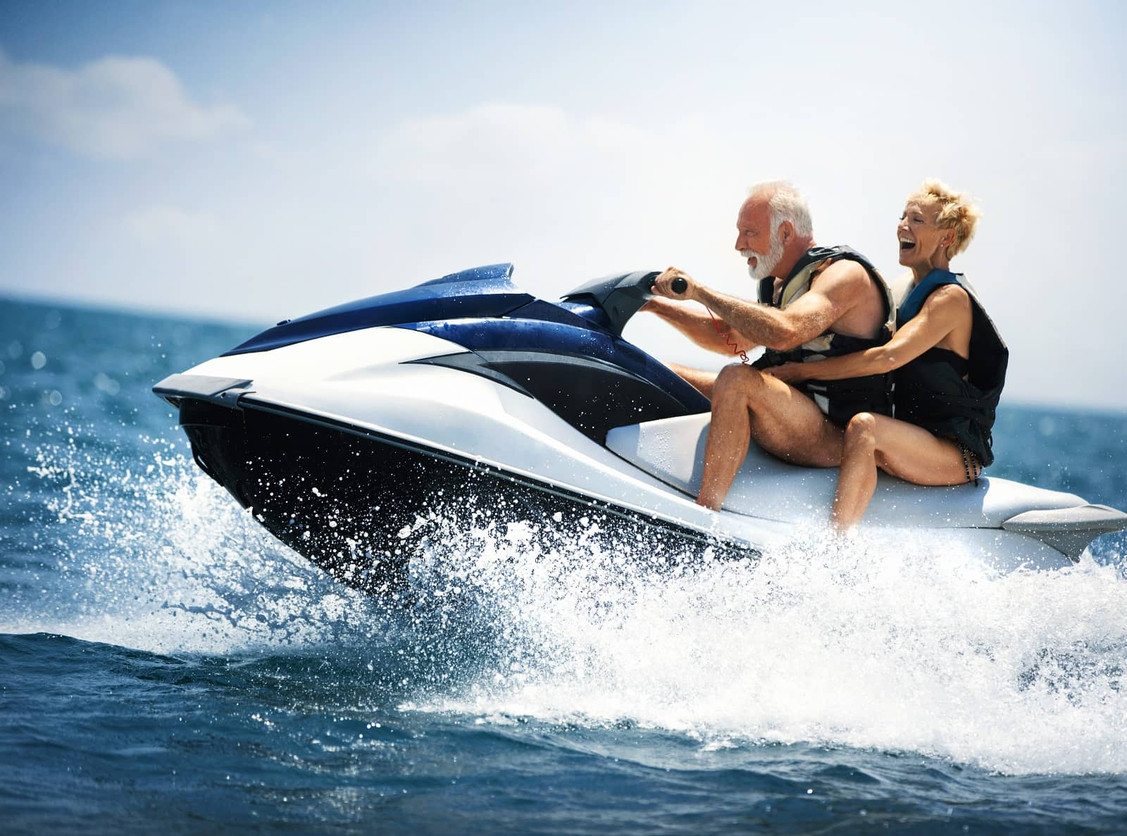 Older couple jet-skiing