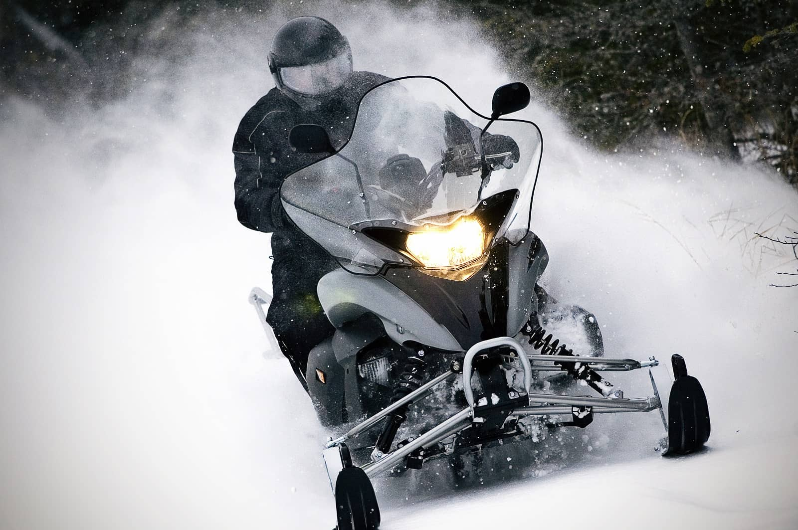 snowmobile kicking up snow