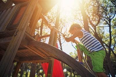 Boy climbing up rope