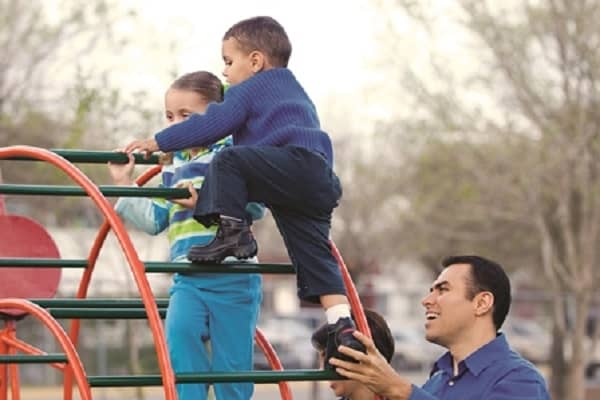 Child climbing on jungle gym