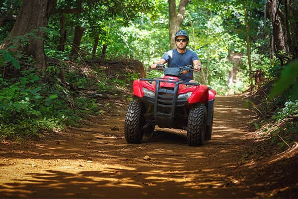 man driving four wheeler in Costa Rica