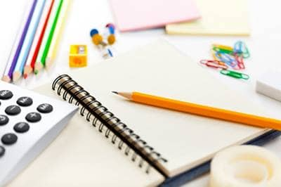 Blank notebook and school supplies