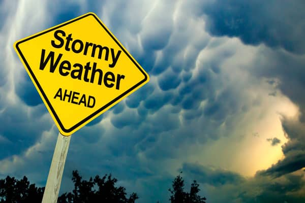 Stormy weather sign in front of rolling clouds