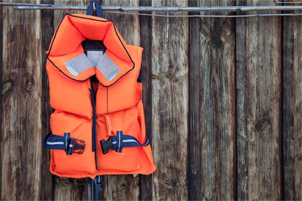 Life jacket hanging on fence