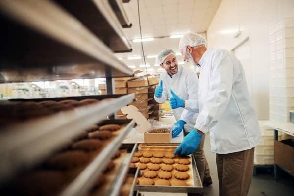 two bakers preparing food