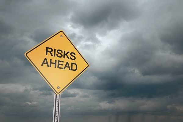Risks ahead yeild sign