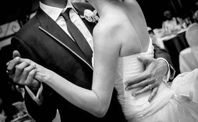 Newlyweds dancing on wedding day