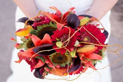 Bride holding fall wedding bouquet